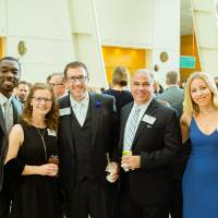 Marcus Wallace, Erika Wallace, Jodi Chycinski, and guests at the Enrichment Dinner